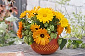Late summer bouquet in pumpkin vase