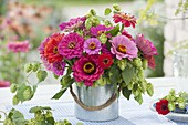 Late summer bouquet of Zinnia and Humulus lupulus
