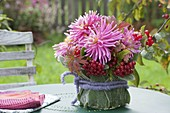 Small bouquet of Dahlia 'Pink Monk', red berries