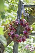 Wreath made of Aster, Sedum and Rosa