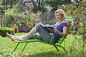 Woman enjoys the garden
