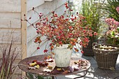 Bouquet of different roses and autumn leaves on rusty table