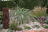 Gravel garden with grasses and perennials