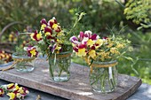 Small bouquets of Antirrhinum (snapdragon) and fennel flowers