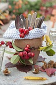 Terracotta pot naturally decorated as a cutlery holder