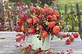 Autumn bouquet of physalis, Rosa, Erica gracilis