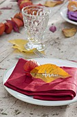 Autumn table decoration with lanterns and autumn leaves
