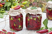 Red hot peppers (Capsicum annuum) pickled sweet and sour in jar
