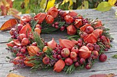 Autumn wreath made of physalis, malus, Rose