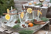 Empty glasses for punch, slices of orange, cinnamon sticks, star anise