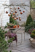 Christmas terrace with copper balls on the branch