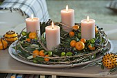 Mediterranean Advent wreath with fruits of Calamondin oranges