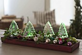 Christmas forest decoration with colored Led trees