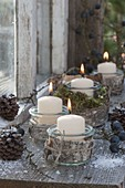 Preserving jars as lanterns with birch bark, cones, sloes