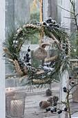 Birdseed wreath made from Pinus (pine), Blackthorn (Prunus spinosa)