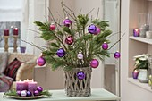 Bouquet of branches of Pinus branches berry-colored decorated