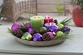 Bowl with candles, balls, cones, pinus (pine) branches