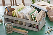 Box with seeds sorted by months for the garden year