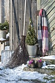 Still life at the tool shed with snow shovel, brush, Picea