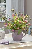 Cornus mas and Tulipa bouquet in ceramic jug