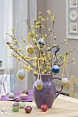 Easter bouquet of Cornus mas branches, easter eggs