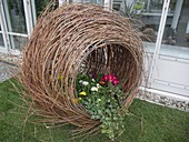 Planted roll of branches as unusual decoration