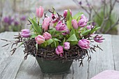 Tulips arrangement in wreath of birch vines