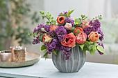 Fragrant bouquet of syringa (lilac), ranunculus (ranunculus)