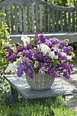 Lush Syringa and Malus branches bouquet