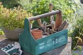Garden toolbox with strap handle pots, brush, hand scoop