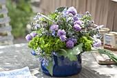 Herbal bouquet in blue saucepan, parsley, chive
