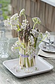 Bouquet of asparagus flowers with valerian flowers