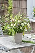 Bouquet of meadow flowers, leucanthemum, grasses, trifolium