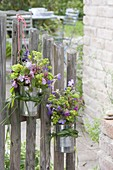 Small bouquets hung in clean tin cans on the garden gate