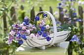 Basket of freshly cut flowers of Aquilegia (columbine)