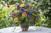 Colorful bouquet of Rose, alchemilla, campanula