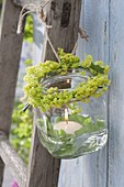 Preserving jar used as a lantern with a flowers profusion
