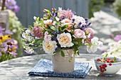 Fragrant summer bouquet of roses, lathyrus, hydrangea