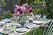 Fragrant table decoration of Phlox paniculata, Lathyrus