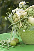 White-green bouquet with summer flowers, fruits and vegetables
