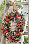 Autumn wreath of Hydrangea, Zinnia, Sedum