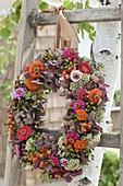 Autumn wreath of Hydrangea, Zinnia, Sedum