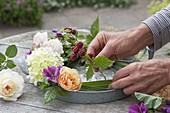 Flower wreath with candles on zinc tray