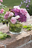 Rural bouquet of hydrangeas, roses, blackberries