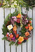 Autumnal wreath at the fence