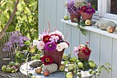 Patio table with apples and small Zinnia bouquets