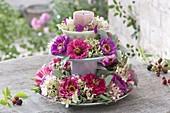 Made of crockery self-made cake stand with zinnia wreaths