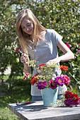 Putting cottage garden flowers bouquet