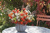 Autumn bouquet with physalis, aster, miscanthus