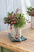 Small bouquet of Pinus, Ilex, Rosa